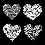 White sketched hearts set on black background Stock Photos