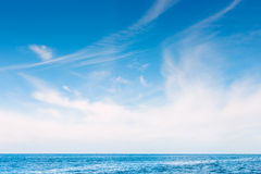 White skies over the blue ocean Royalty Free Stock Photo