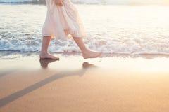 White Skirt Woman Legs Walking on Beach Vacation Stock Photos