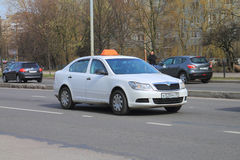 The white Skoda car with a taxi checkered pattern Royalty Free Stock Photography