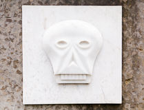 Bas-relief, skull on a gravestone Royalty Free Stock Photo