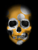 White skull with golden circles Stock Image