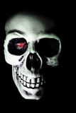 White Skull with Red Eyed Glow royalty free stock images