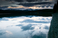 White Sky Reflection Through Clear Water Stock Photo