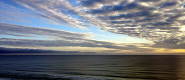 White Sky Under Blue Sea during Dawn Royalty Free Stock Photo