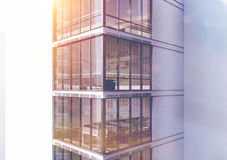 White skyscraper exterior, corner, toned. Corner of an exterior of a white skyscraper with large windows and a gigantic posters by their sides. 3d rendering Stock Photos
