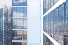 White skyscraper exterior, side. Side view of an exterior of a white skyscraper with large windows and a gigantic poster between them. 3d rendering, mock up Royalty Free Stock Photo