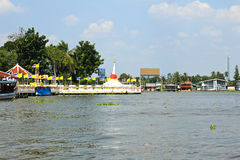 White slant pagoda located at river side at Koh Kret Royalty Free Stock Photos