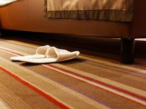 White slippers bedroom. White slipers bedroom with moquette royalty free stock photography