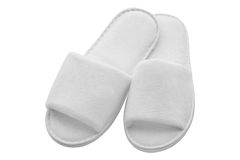 White slippers for hotel or home - spa relax - isolated Royalty Free Stock Image