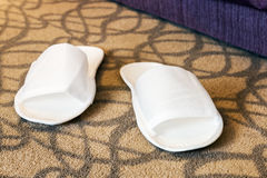 White slippers near the bed Royalty Free Stock Photography