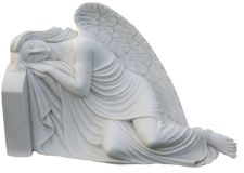 White Slumber Angel. A white stone angel sleeping on a stone in grief Royalty Free Stock Images