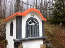 White small chapel. Small white chapel on Ucka mountain in the forest Stock Image