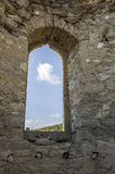 White small cloud in old stone arc window. Europe Stock Photos