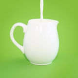 White small jug on a green background Royalty Free Stock Images