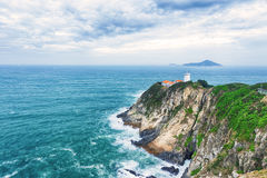 White small lighthouse. Hong Kong Royalty Free Stock Photos