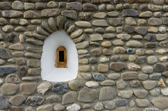 White small window on stone wall. Small window detail on stone wall Stock Photography