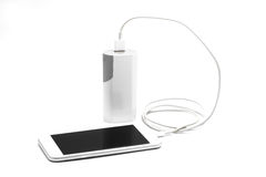 White smart phone charger with power bank (battery bank) Royalty Free Stock Photography