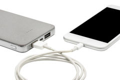 White smart phone charger with power bank (battery bank) Royalty Free Stock Photos