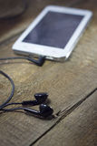 White smart phone with earphones.  Stock Photography