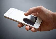 White Smart Phone in the Hand Royalty Free Stock Images