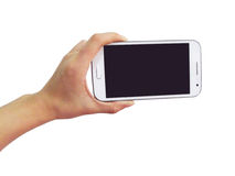 White smart phone in hand Stock Photography
