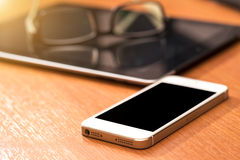 White smart phone with isolated screen on old wooden desk. Stock Images