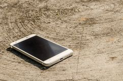 White smart phone with  screen on desk focus on bottom Royalty Free Stock Image