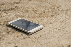 White smart phone with  screen on desk Stock Images