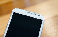 White smart phone wood background Royalty Free Stock Images