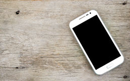 White Smart phone on wood background, White mobile phone stock photography