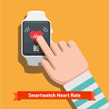 White smart watch showing heart beat rate app Royalty Free Stock Photography