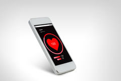White smarthphone with red heart icon screen. Technology, health care, application and electronics concept - white smarthphone with red heart icon screen Stock Photo