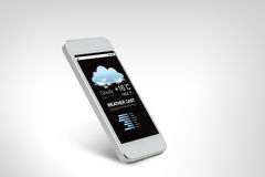 White smarthphone with weather forecast on screen Stock Photography