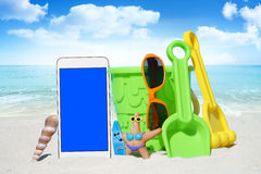 White Smartphone and Beach Toys Stock Photo