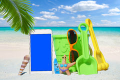 White Smartphone and Beach Toys Royalty Free Stock Image