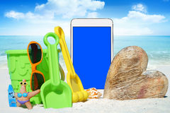 White Smartphone and Beach Toys Stock Images