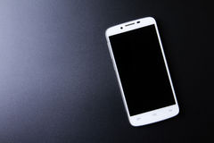 White smartphone concept on dark background Royalty Free Stock Photography