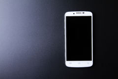 White smartphone concept on dark background Royalty Free Stock Photos