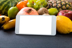 White smartphone with empty screen. Over fruity background Royalty Free Stock Photo