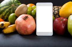 White smartphone with empty screen. Over fruity background Royalty Free Stock Photos