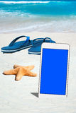 White Smartphone and Flip Flops Royalty Free Stock Photography