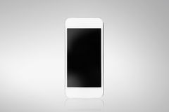 White smartphone on a gray background Stock Image
