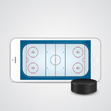 White smartphone with ice hockey puck and field on the screen. Stock Photos