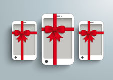3 White Smartphone Red Gibbon Gift. White smartphone with red ribbon on the grey background Stock Photos
