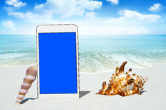 White Smartphone and Seashells Royalty Free Stock Photography