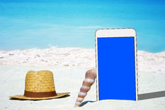 White Smartphone and Straw hat Stock Photos