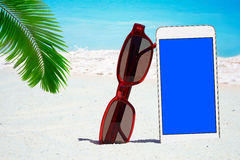 White Smartphone and Sunglasses Royalty Free Stock Photography