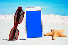 White Smartphone and Sunglasses Stock Photography