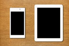 white smartphone and tablet pc on the table Stock Photo